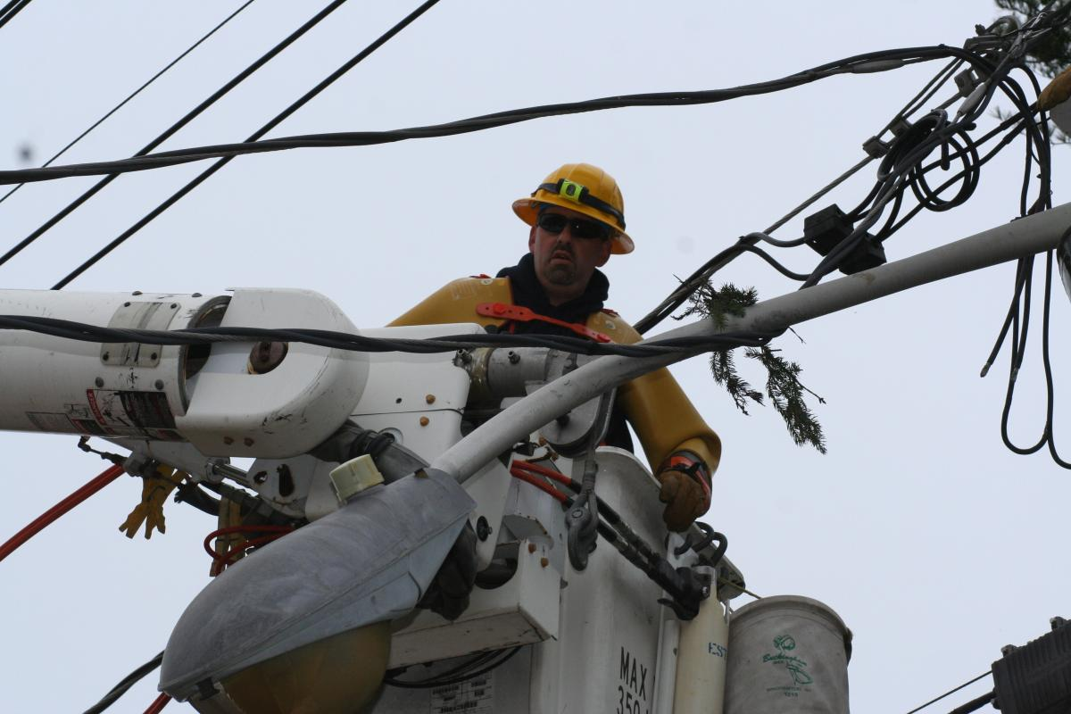 Electric Lineman in Bucket Truck