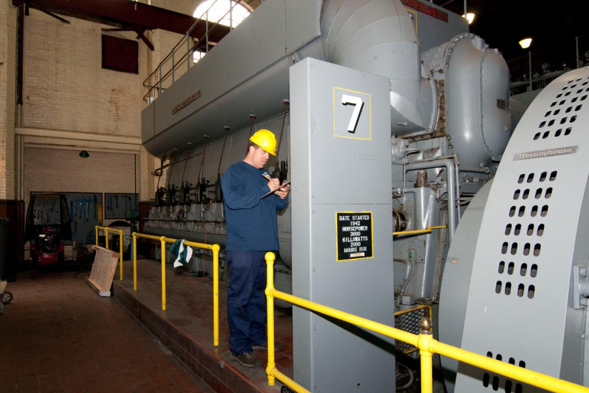 Power Plant Employee with Engine Generator