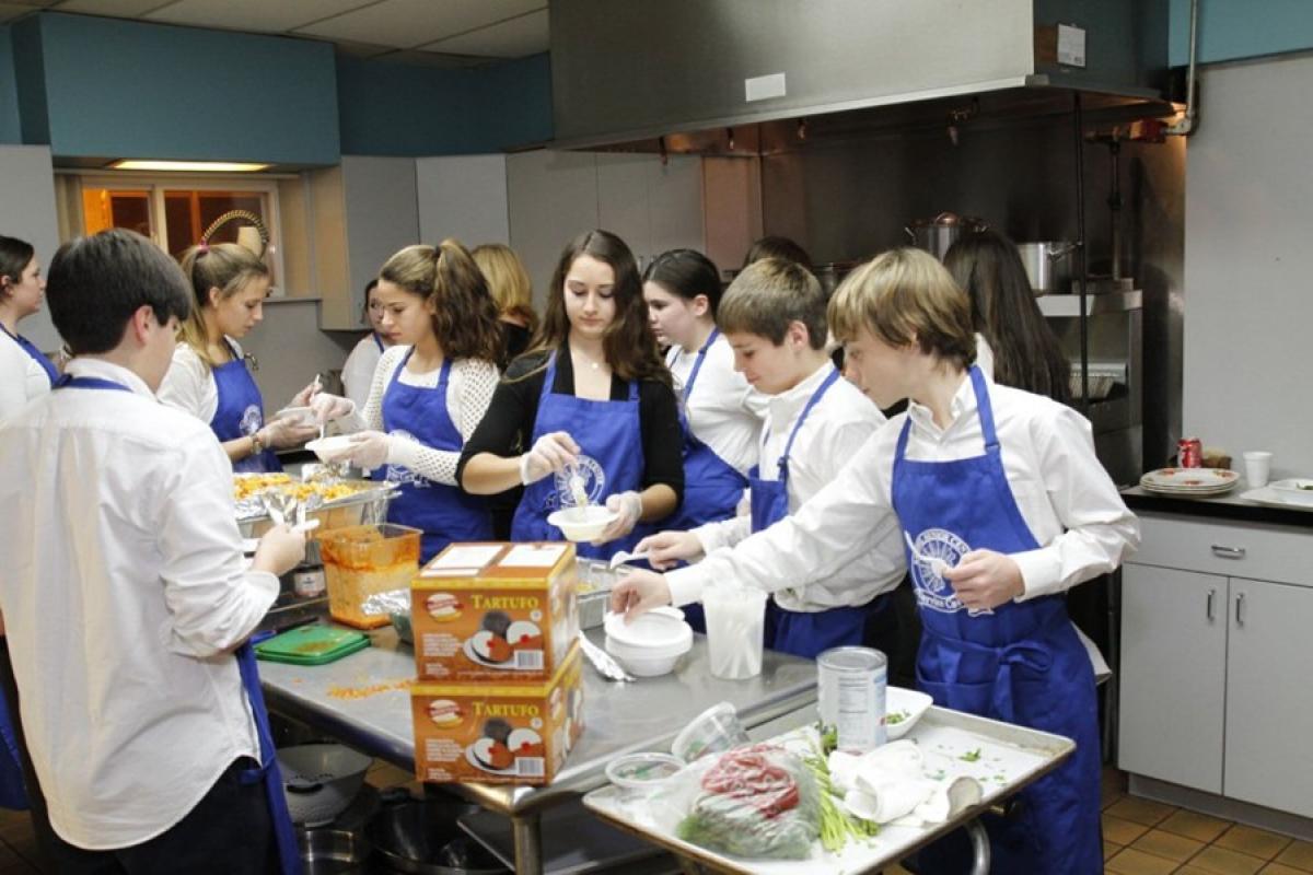 Volunteer Group Preparing a Meal